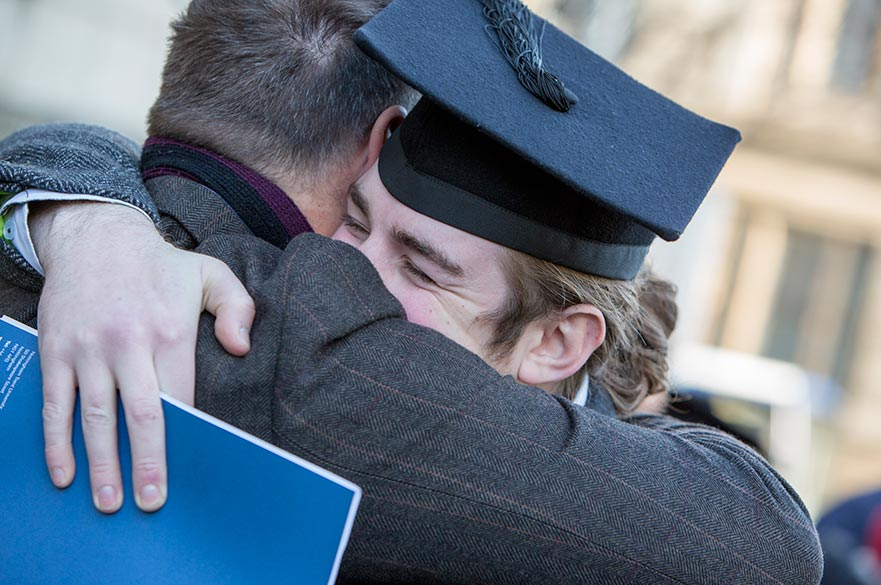 student-hugs-parent-at-ntu-graduation