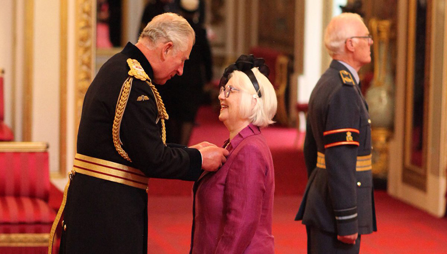 Joan Salter receiving her MBE