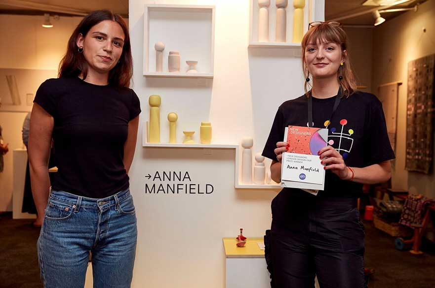 Anna Manfield receiving her award at New Designers