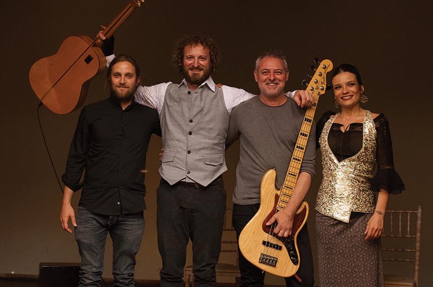 David Buckingham, his band and flamenco dancer Aloma de Balma stood together.