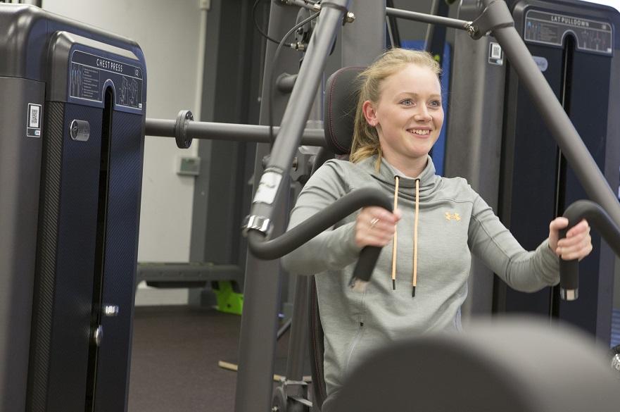 female using gym equipment