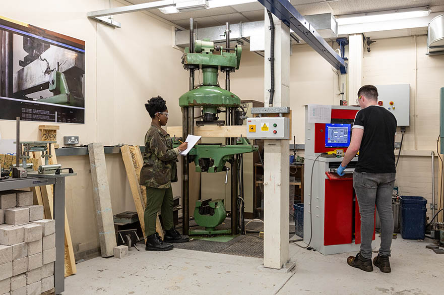 Students working with structural testing machinery in our Maudslay workshops