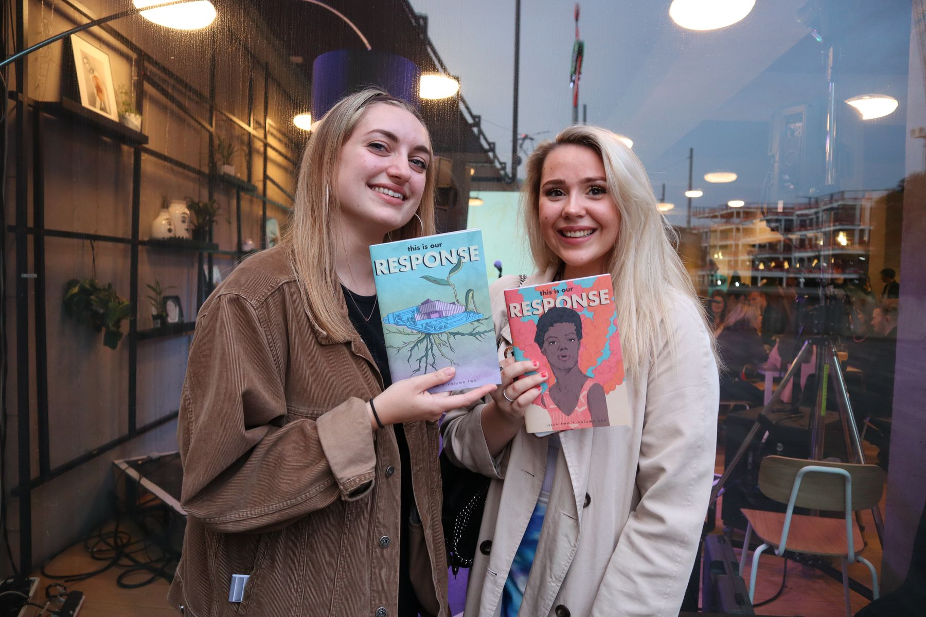 Students holding copies of the RESPONSE publication
