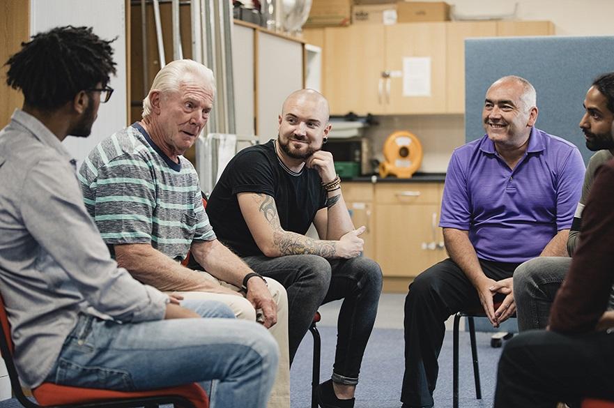 Men sitting in a group talking
