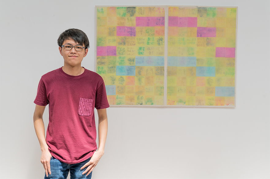Student creates rainbow artwork using sticky notes to remember lockdown