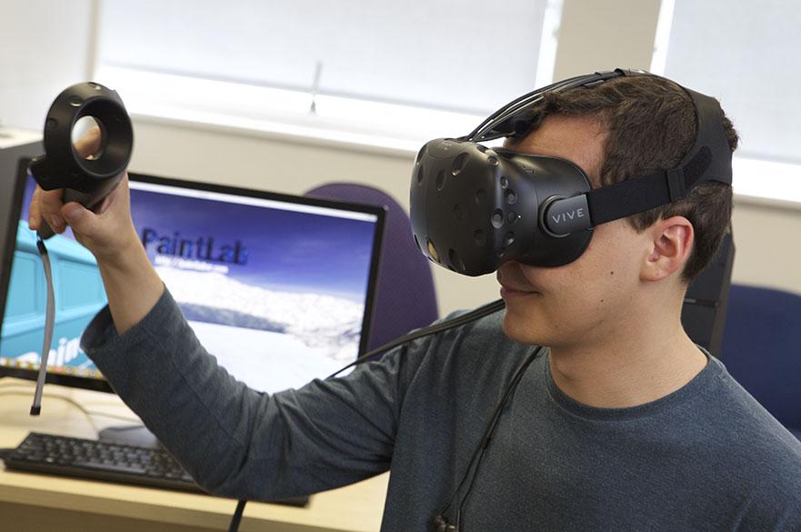 man wearing a HTC Vive Virtual Reality headset