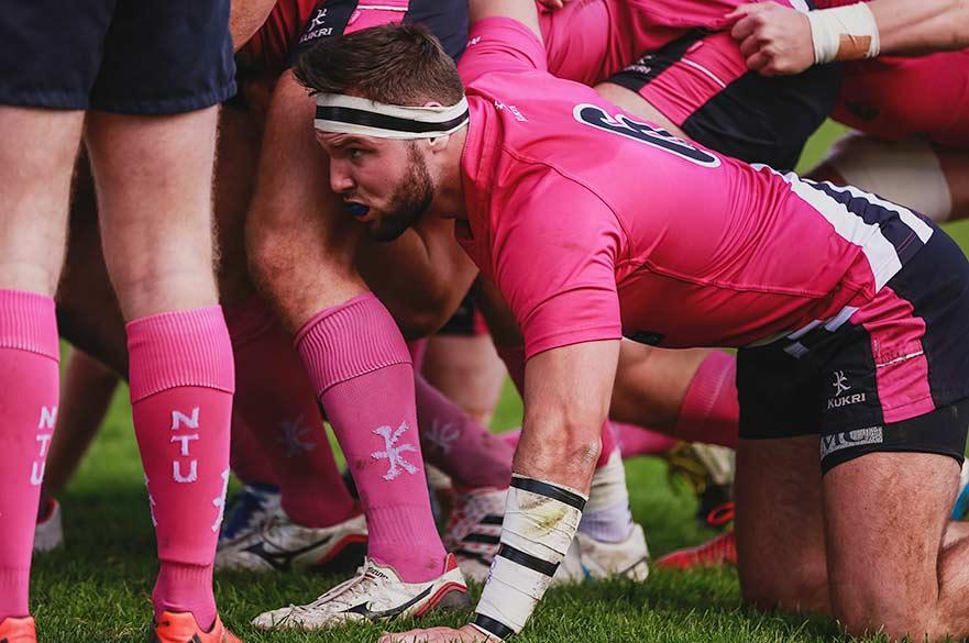 NTU rugby player in scrum