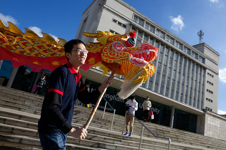 Student with Chinese dragon