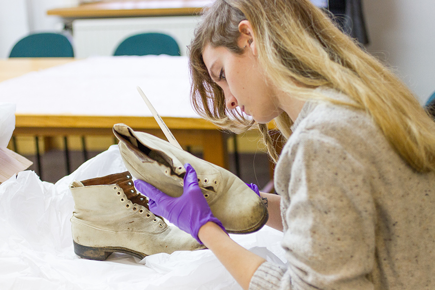 A postgraduate student beginning to clean Harold Larwood's boots