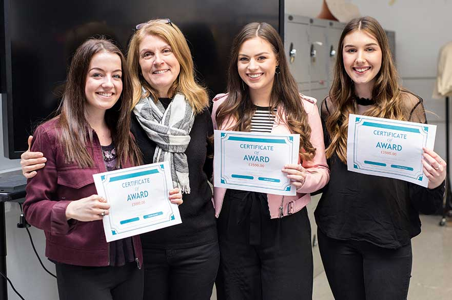Linda with the winning students