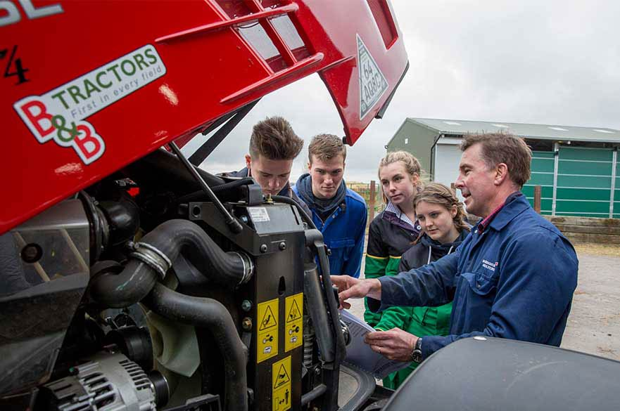 Students learning how a tractor works