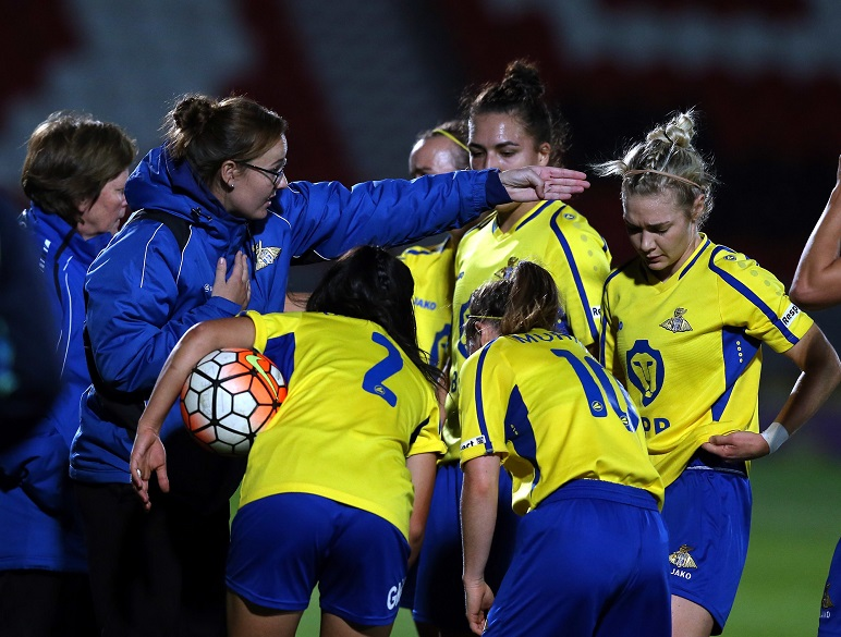 Women's football group huddle