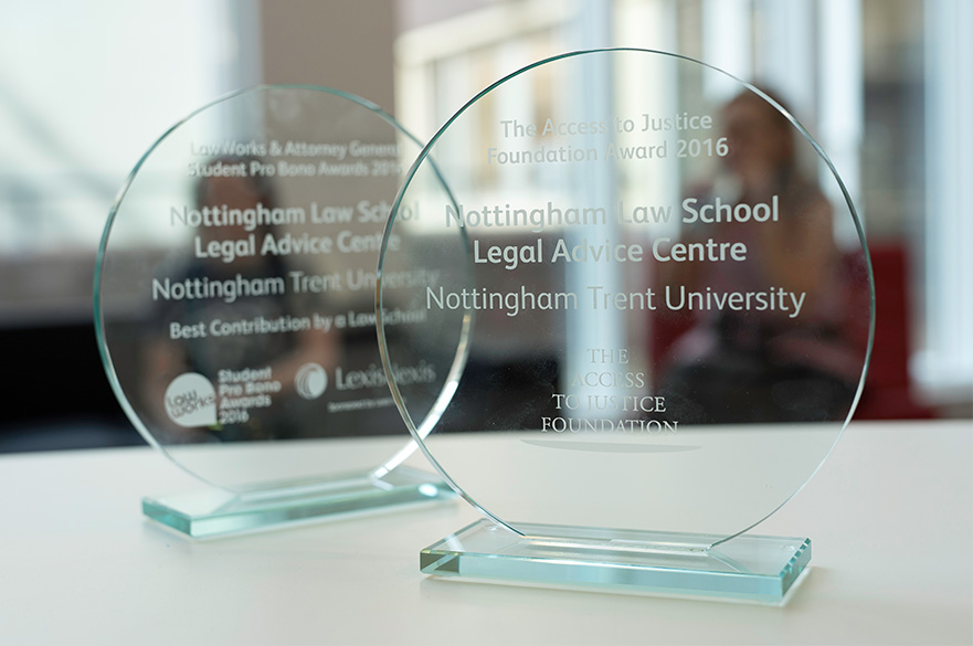 Legal Advice Centre staff holding Awards won by the centre