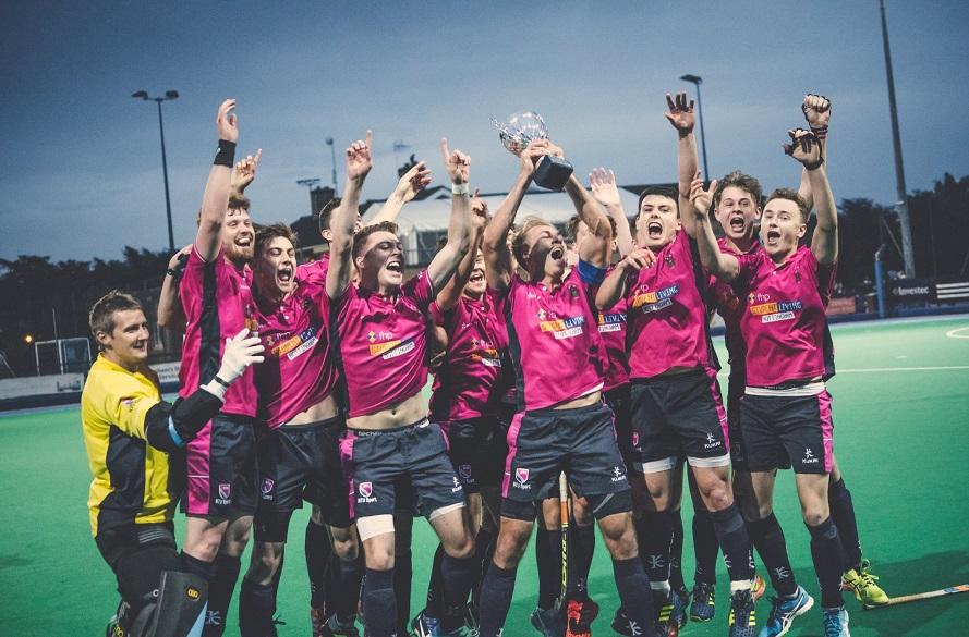 NTU Men's Hockey team lift trophy in celebration of winning 2018 Varsity fixture