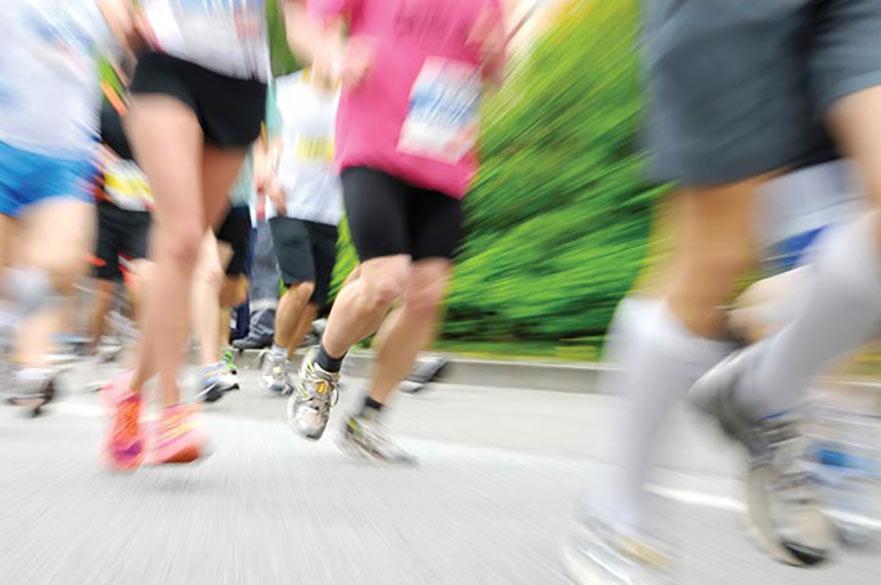 Blurry action shot of running legs