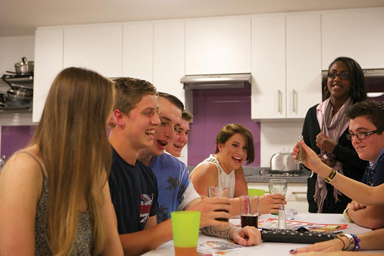 students socialising in an NTU residence kitchen