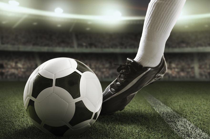 Football boot kicking football