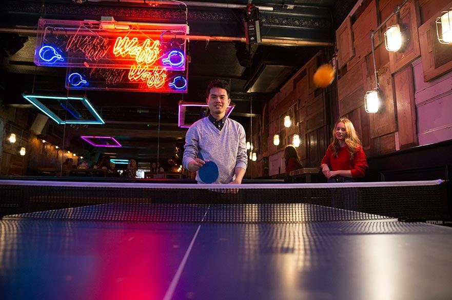 Students play ping pong at Das Kino
