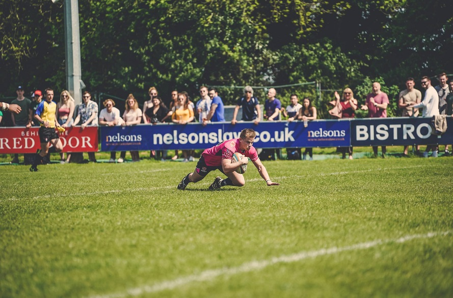 NTU Men's Rugby union player Harry Graham scoring a try