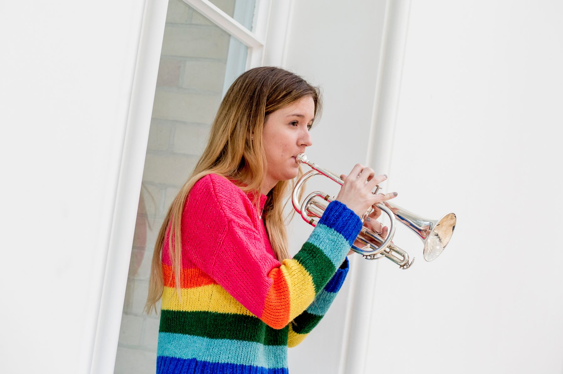 Female student playing trumpet