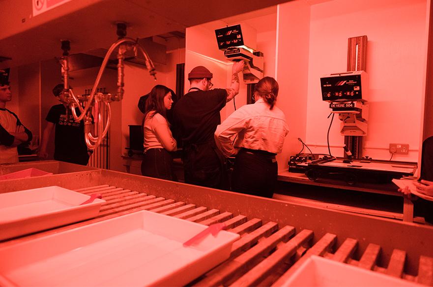 Students working in the darkroom