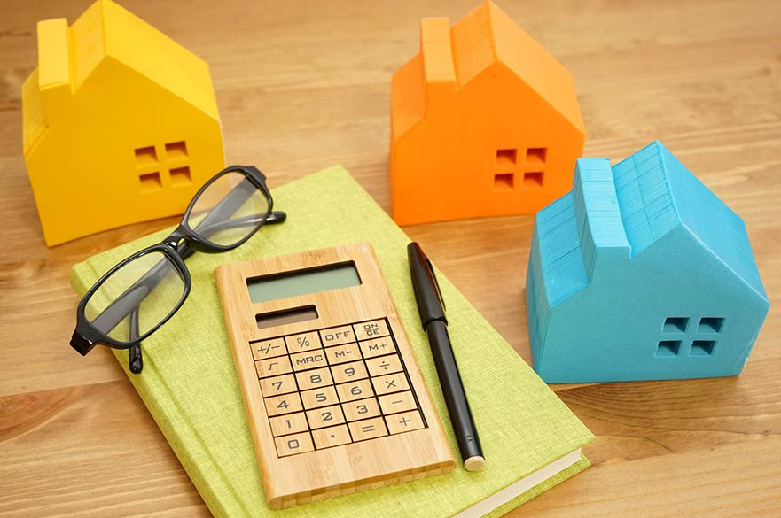 Calculator and model houses on desk