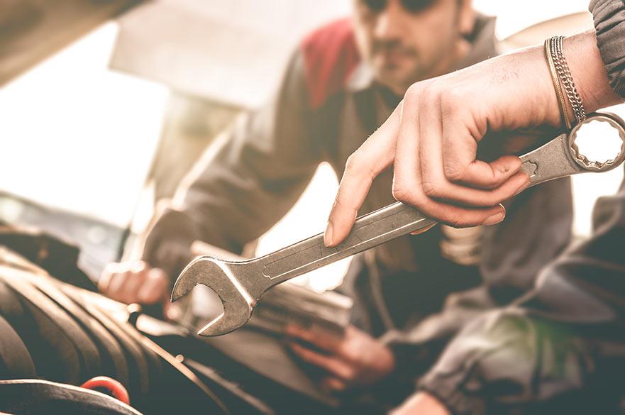 Mechanics look at a car