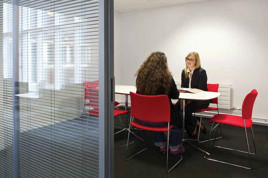 Member of Legal Advice Centre staff in meeting with client