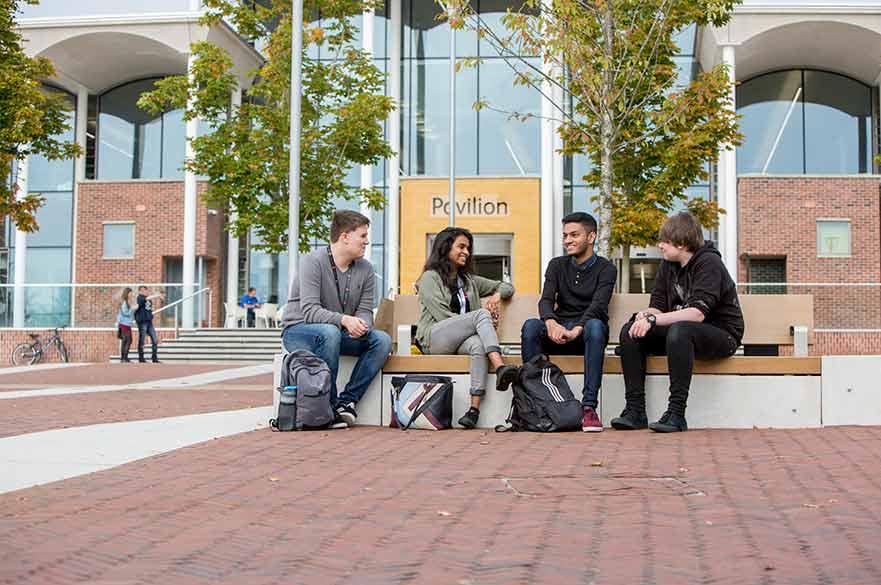 Students sitting outside Pavilion
