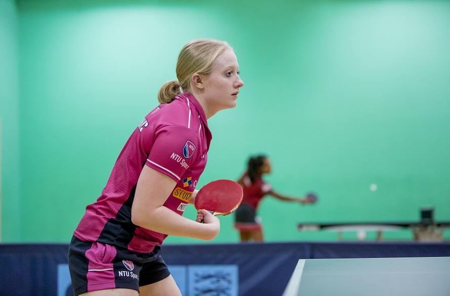 NTU Women's table tennis player about to hit the ball