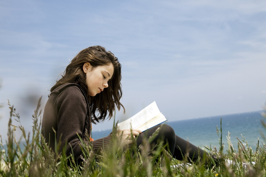 Young woman writing in a book