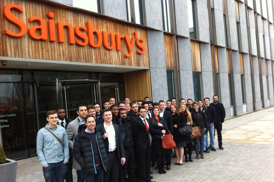 A group of students standing outside Sainsbury's