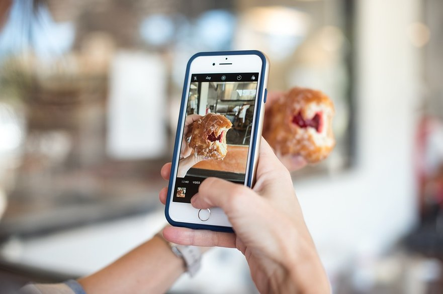 Taking a photo of a doughnut with a phone