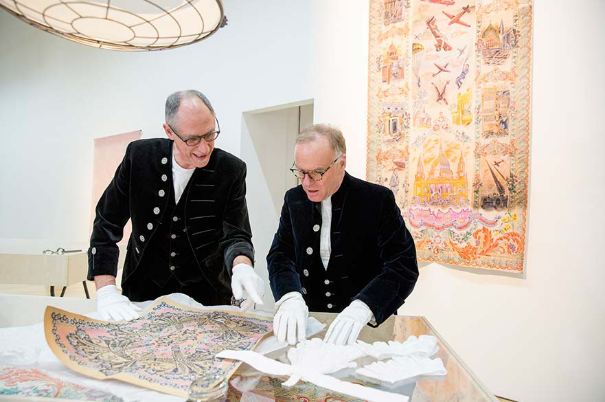 The High Sheriffs looking at the drawings that inspired their jabots