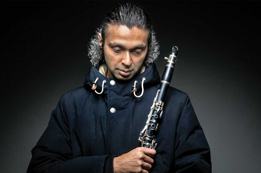 Arun Ghosh stood with his clarinet.