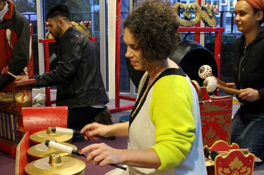 Woman playing metallophone in Gamelan workshop