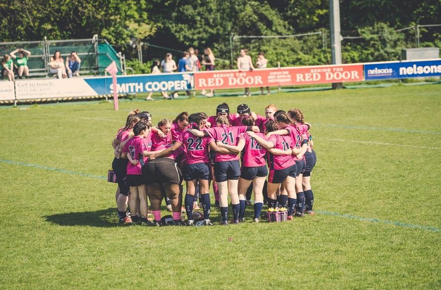 NTU women's rugby team in a huddle