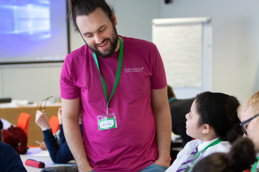 Outreach Ambassador talking to pupils at an NTU campus Outreach event