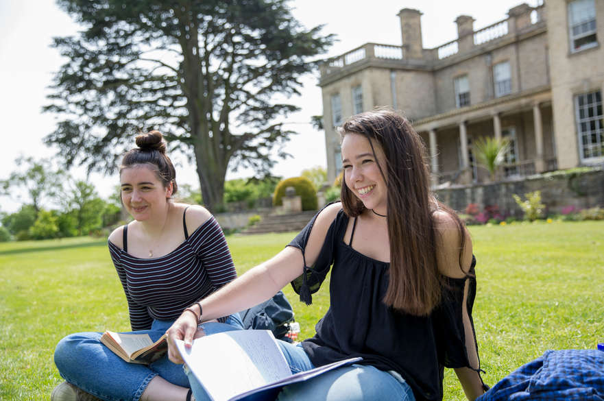 students smiling outside Brackenhurst