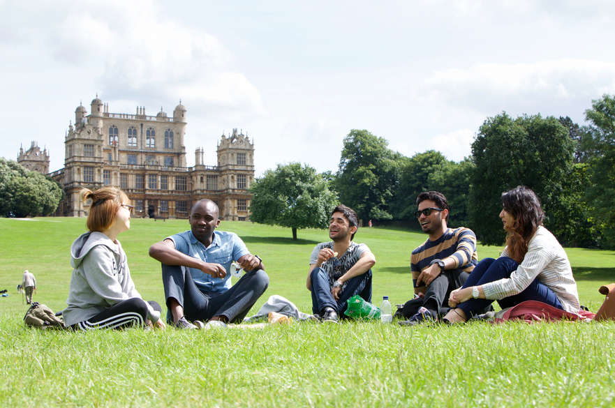 Students sat in front of Wollaton Hall