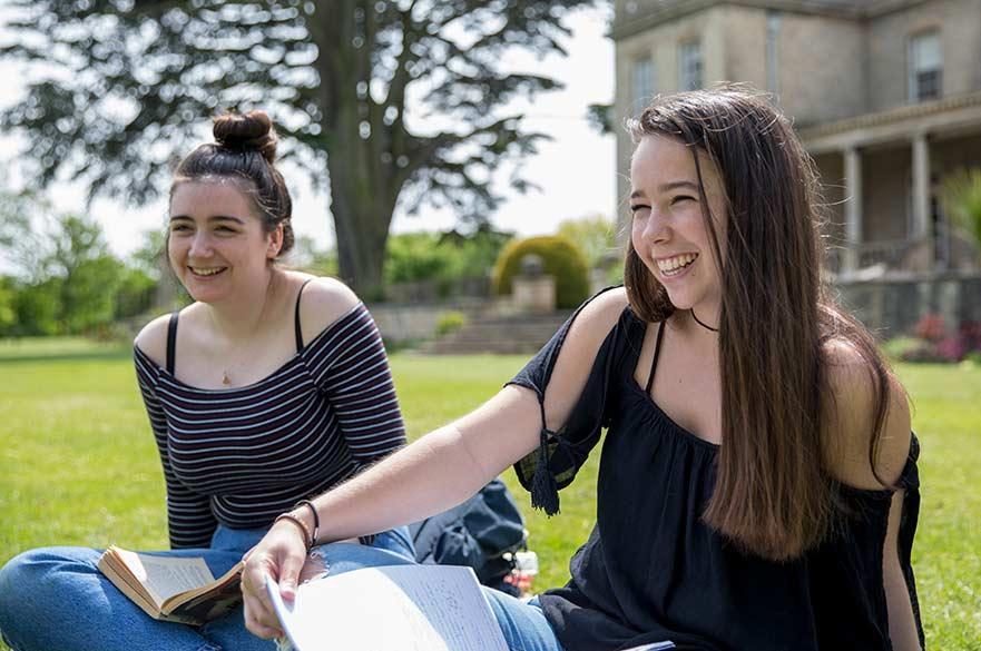 Students sitting on grass at Brackenhurst campus