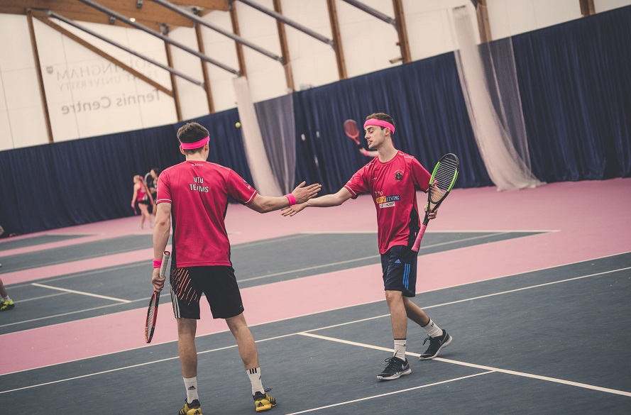 Two NTU Tennis players shaking hands