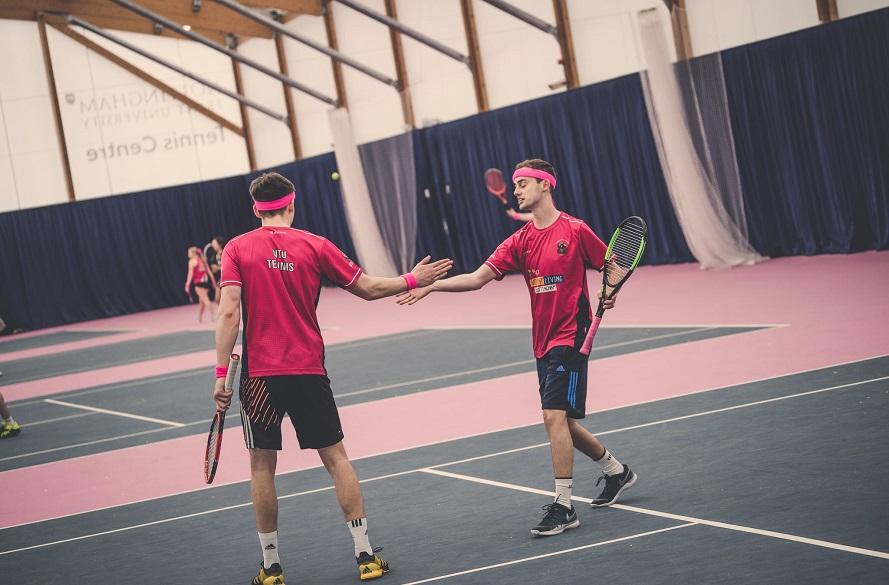 Two NTU Tennis players shaking hands