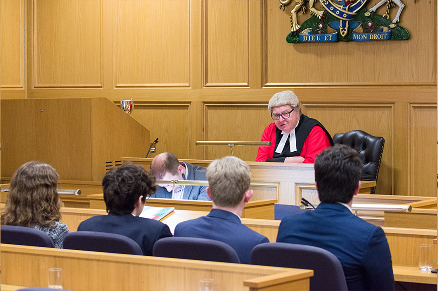 Sitting judge at bench