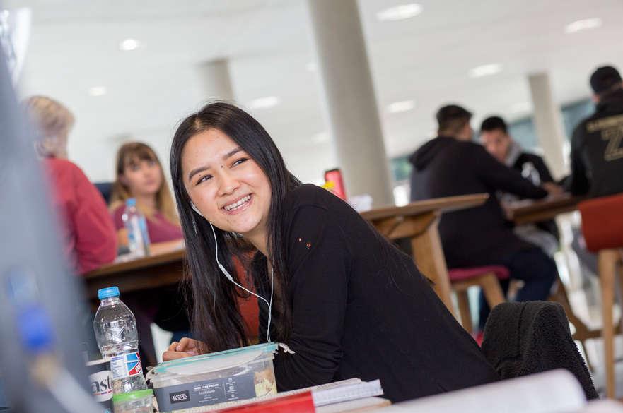 Student sat smiling