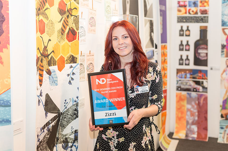 Student Kim Grosvenor with her award