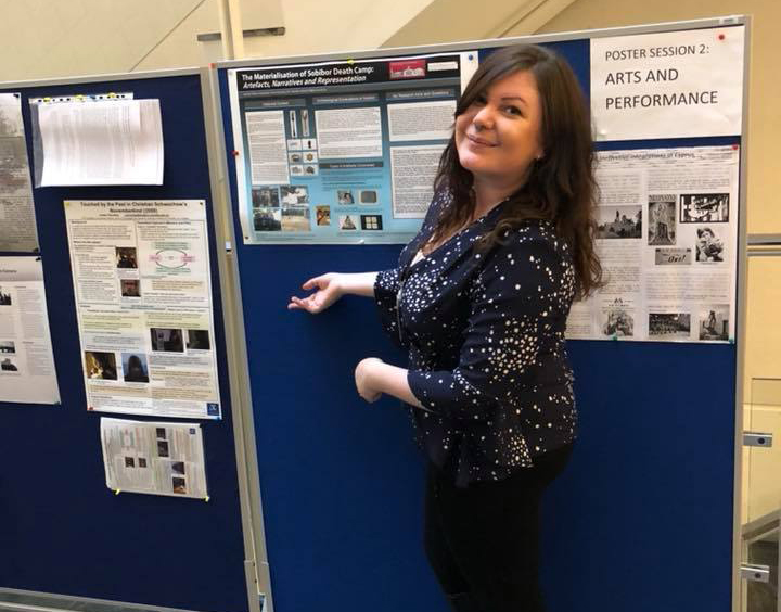 Hannah Wilson with her research poster at the conference