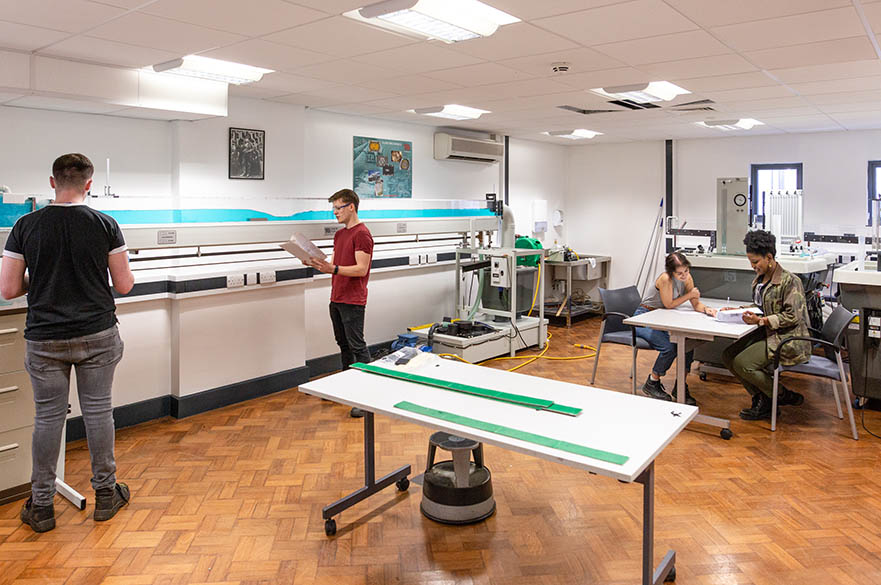 Students testing in the Hydraulics and Fluids laboratory, Maudslay workshops