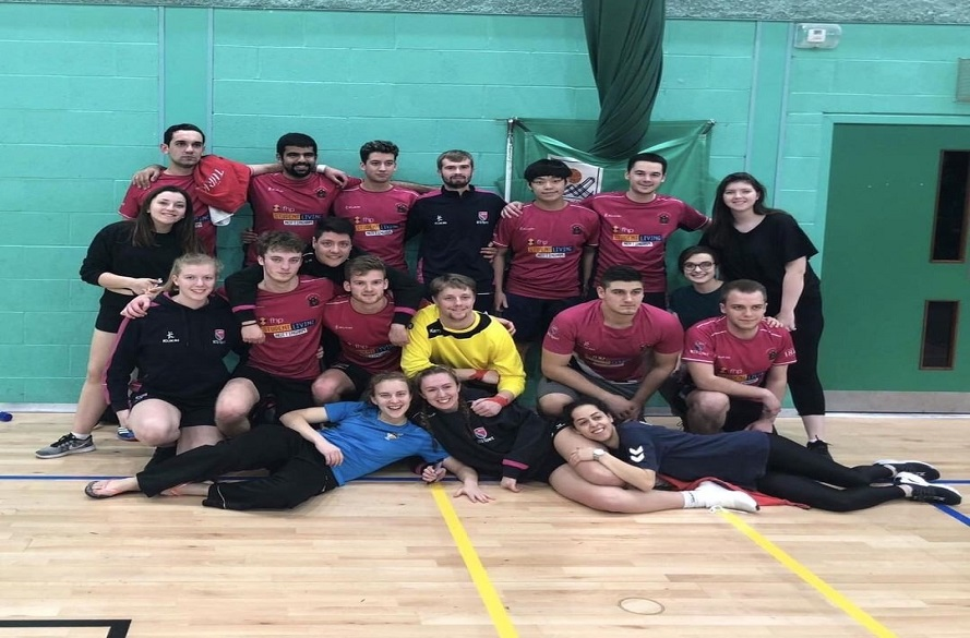 Group photo of the whole NTU handball team smiling