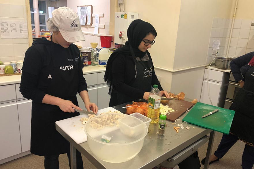 Preparing food at the Muslim and Jewish community café, Salaam Shalom